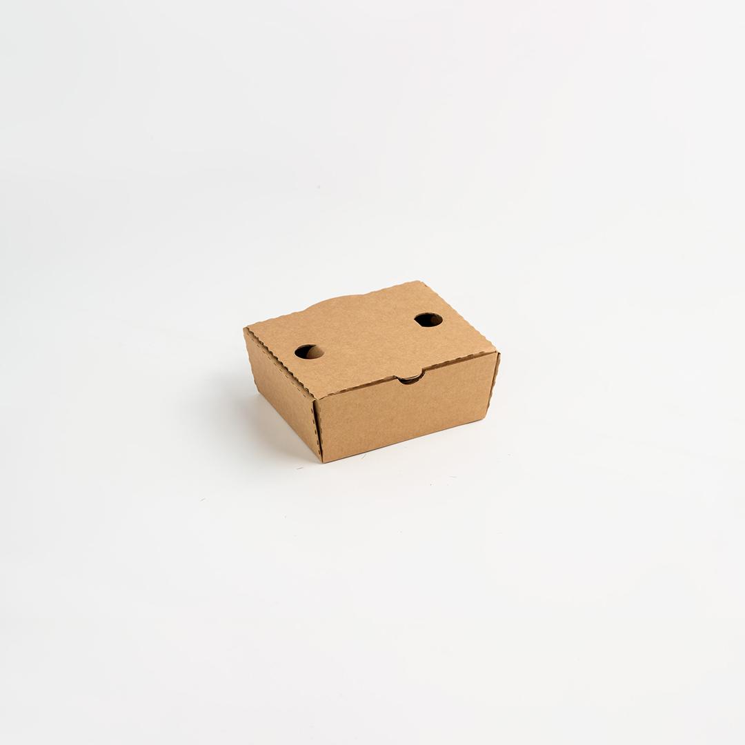 Piccola scatola fustellata con fori